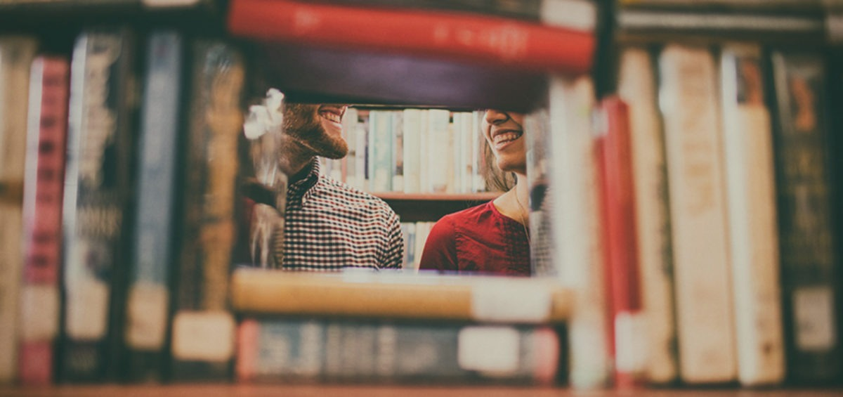 Happy people in a library