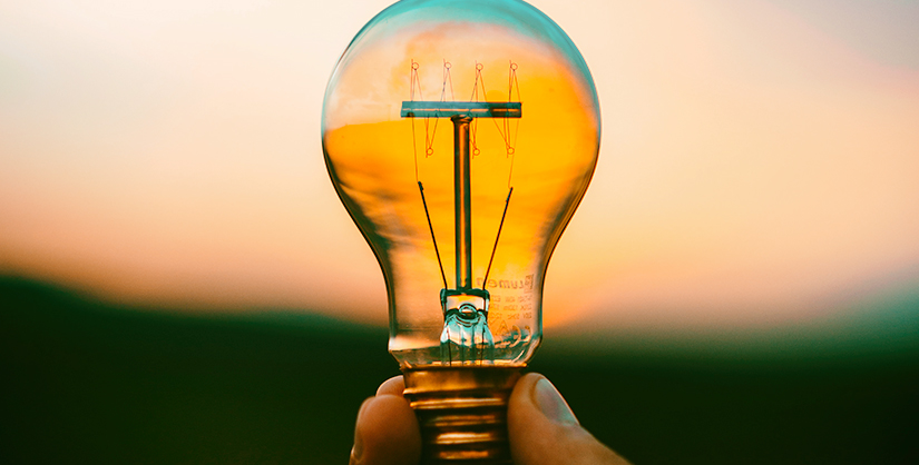 Ideas and strategies - hand holding lightbulb | Readable, free readability analyser