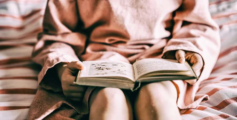 Girl reading book | free readability test