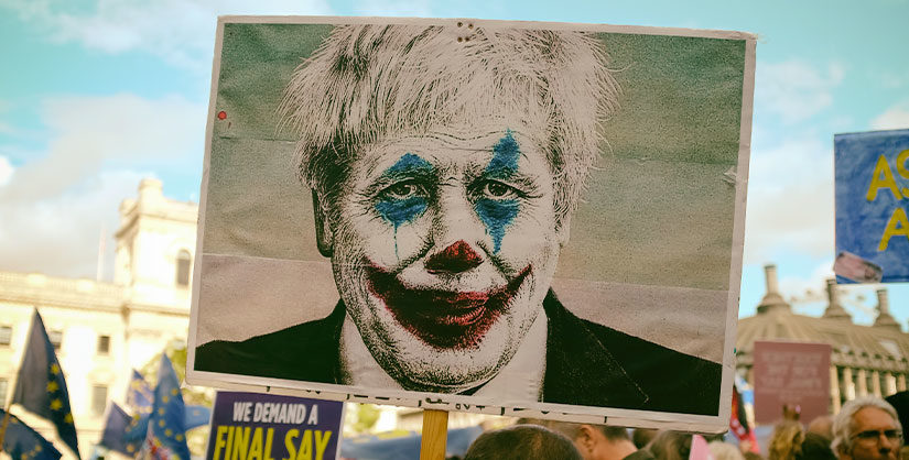 Boris Johnson with clown face paint on protest sign | Readable, free readability test