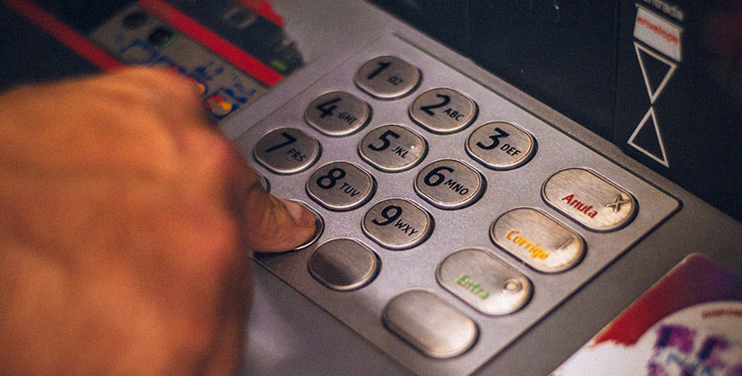 Person keying in PIN at ATM | Readable, readability for financial services
