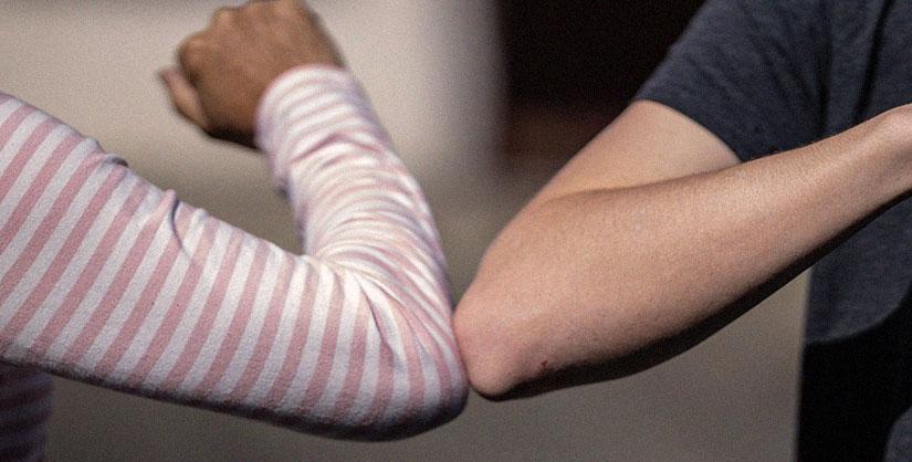 Two elbows bumping | Pandemic clichés blog | Readable, free readability test